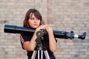 Teen girl and telescope, Near Kiev,Ukraine